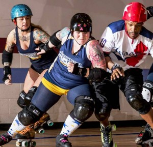 Kitty Klime of Philly Roller Girls (center) hits Jersey boy Rollomite (photo by David A Carter Photography)